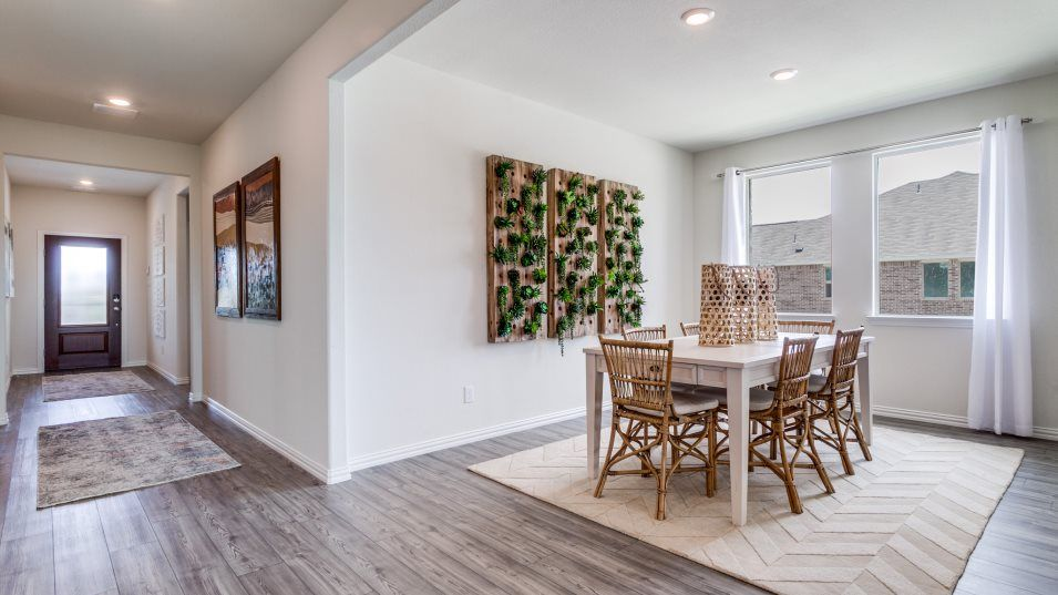 Trinity Crossing 50 Harmony Dining Room:In addition to the breakfast nook, there is also a formal dining room beside the kitchen for family