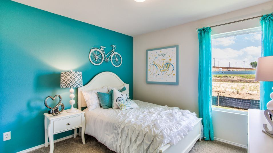 Highbridge Windhaven Bedroom 2:With a total of three bedrooms, this home works well for growing families or anyone in search of ext