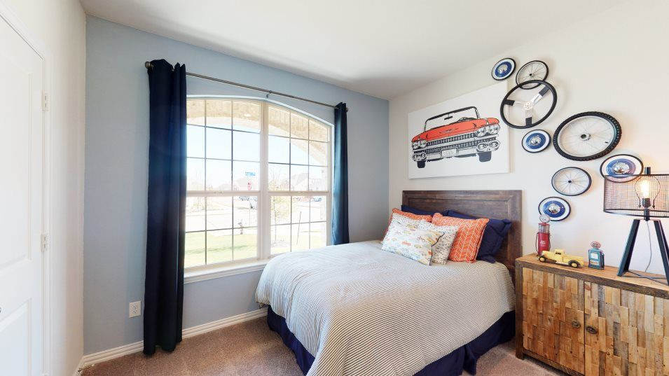 Overland Grove Classic Harmony Bedroom 2:The second bedroom includes a walk-in closet and an adjacent bathroom.