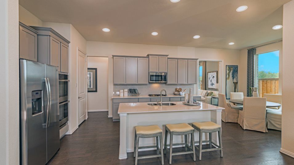 Elements at Viridian Hepburn Kitchen:The open kitchen has a flexible layout that overlooks the family room and includes stainless steel a