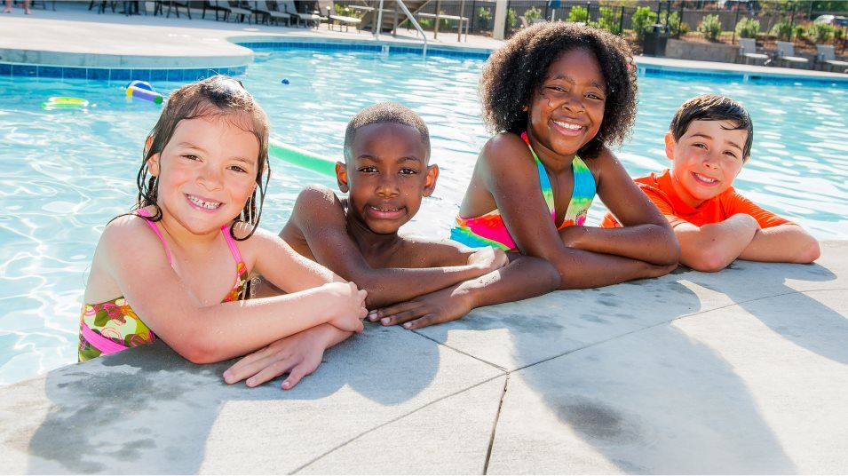 Kids relaxing at a swimming pool