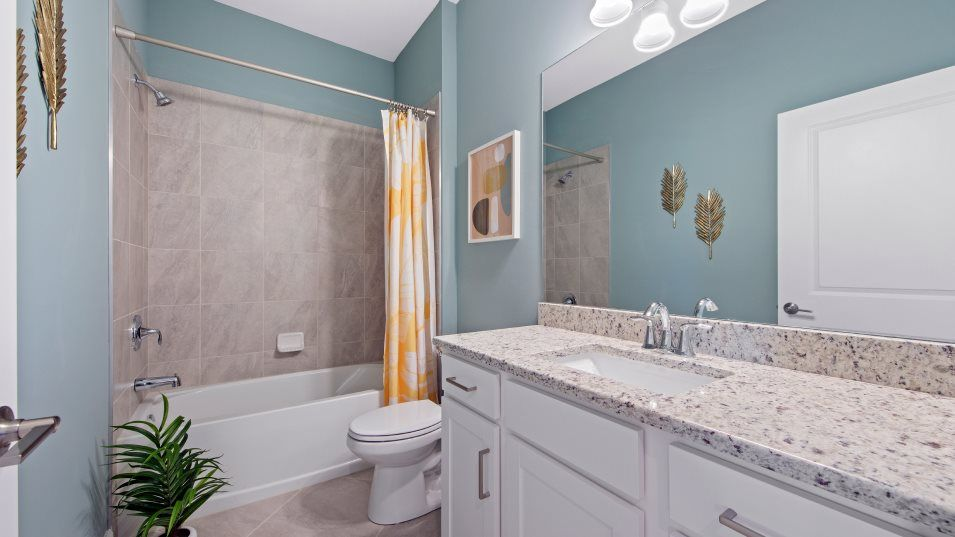 Biscayne-Landing Villas Orchid Bathroom 2:Simple touches, like a granite vanity top and designer lighting, offer a luxurious experience in thi