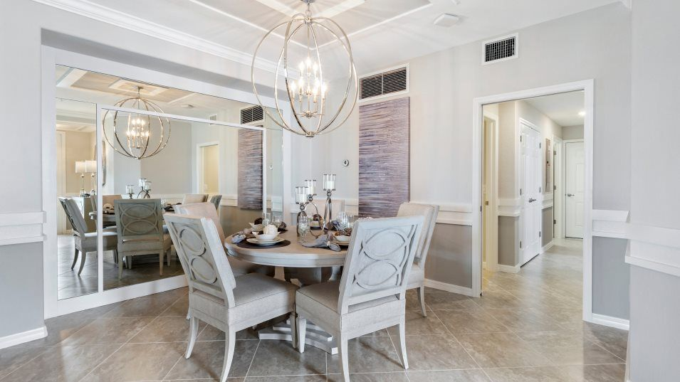 Heritage Landing Coach Homes Arrowhead Dining Room:Delicious meals in the dining room can also easily venture onto the spacious lanai for indoor-outdoo