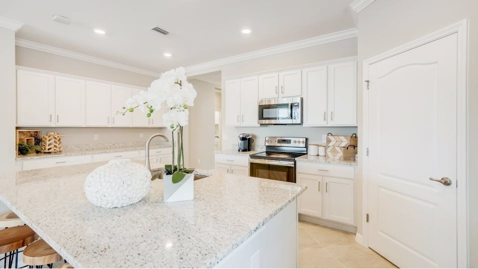 The Isles at West Port Marsala Kitchen:For the inspired home chef, this modern kitchen features a wide layout for easy cooking that include