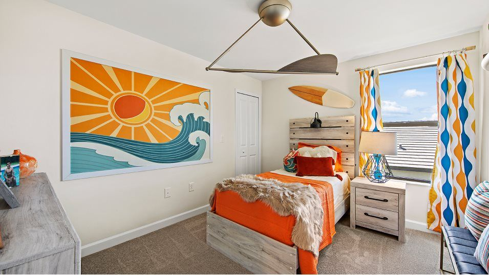 Arborwood Preserve Executive Homes Amalfi Bedroom:A secondary bedroom with a walk-in closet and nearby access to a shared bathroom.