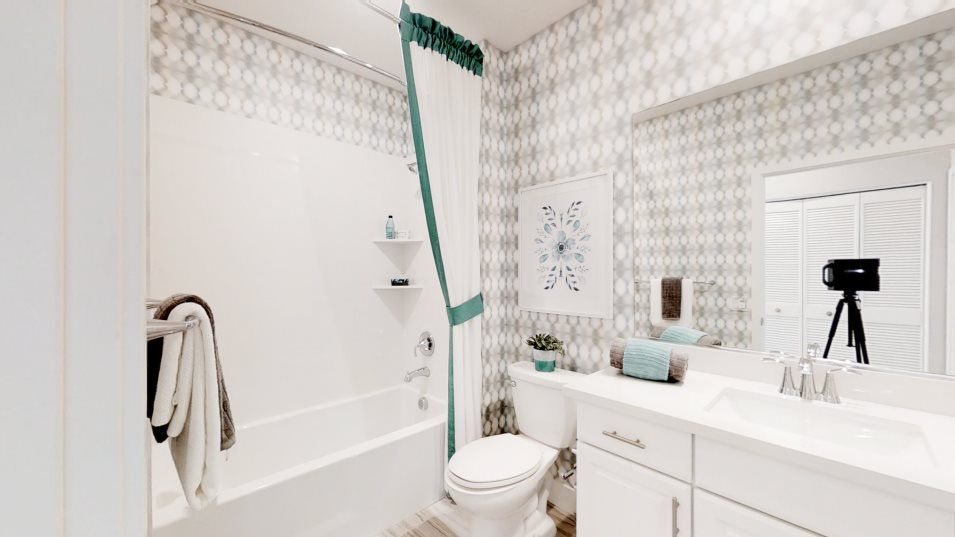 Heritage Solaire Meridian Residence 1445 Bathroom:A full bathroom is situated near the secondary bedroom, equipped with a full-width vanity mirror and