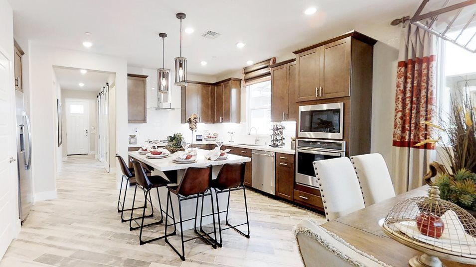 Heritage Solaire Meridian Residence 1712 Kitchen:This corner kitchen includes brand new GE® appliances and smooth granite countertops while a sizable