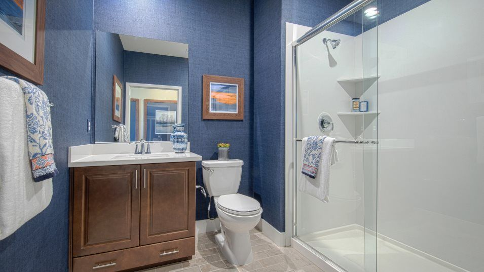 Heritage Solaire Larissa Residence 2064 Bathroom 2:This full bathroom features a spacious glass-enclosed shower.