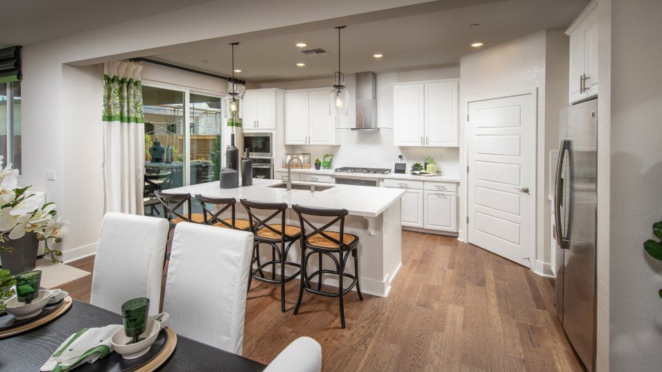 Heritage Solaire Larissa Residence 2309 Kitchen:The modern kitchen showcases on-trend finishes and features, such as granite or quartz countertops,