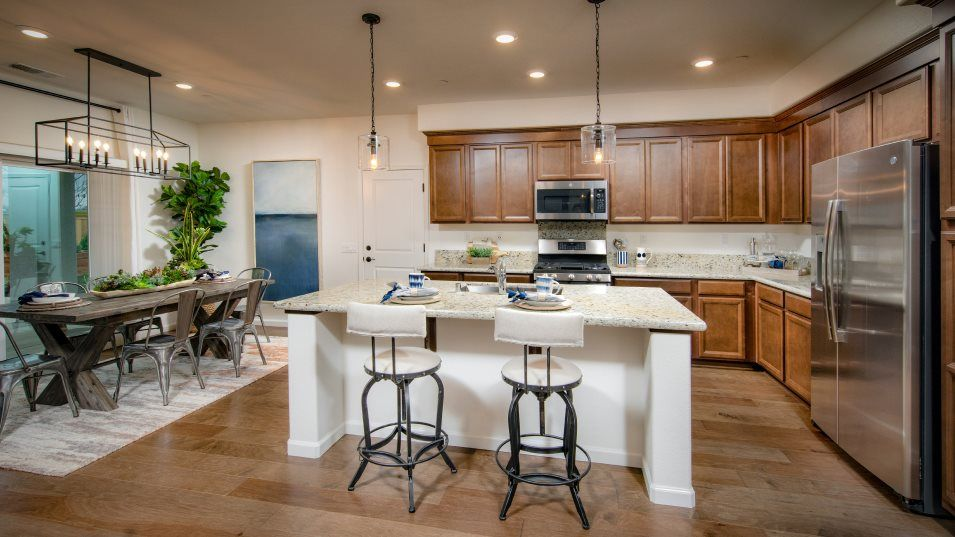Sonoma Ranch Residence 2318 Kitchen:This innovative kitchen features stainless-steel GE® appliances and smooth granite countertops. A si