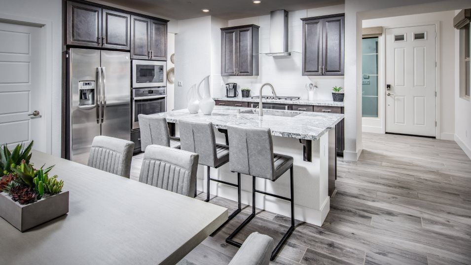 Viridian Residence 1880 Kitchen:Stainless-steel appliances gleam in the gourmet kitchen, which has granite countertops and a center