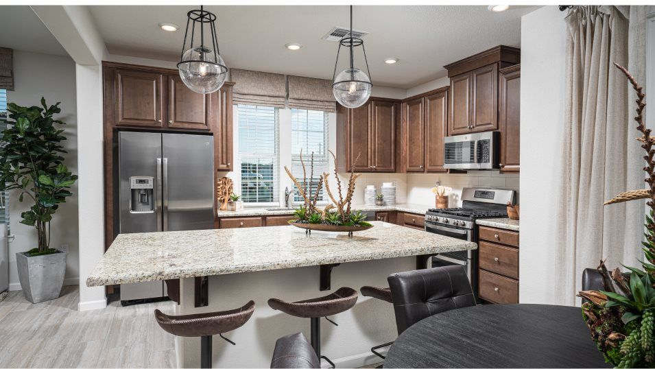 Belle Maison at Campus Oaks Residence 2185  Kitche:With a sizable center island, granite countertops and Moen® fixtures, this kitchen is as functional