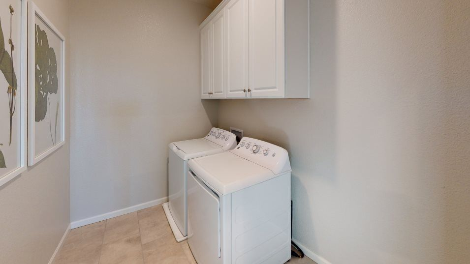 Sausalito Walk at Campus Oaks Residence 1892 Laund:Chores are made simple with a full laundry room, which includes cabinetry and a brand-new washer and