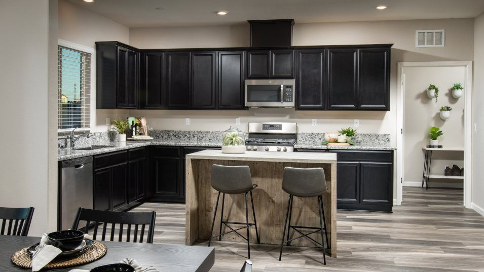 Pavia at Fiddyment Farm Residence 2971 Kitchen:Gleaming cabinetry and brand-new stainless steel appliances brighten the sunlit kitchen, which has a