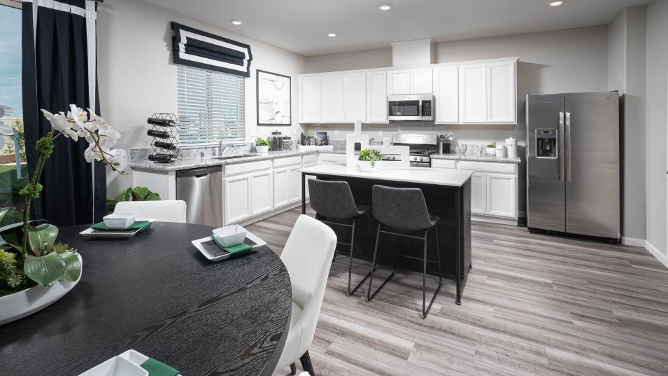 Andorra at Sierra West Residence 2410 Kitchen:In an open layout shared with the dining area, the modern kitchen is equipped with stylish features,