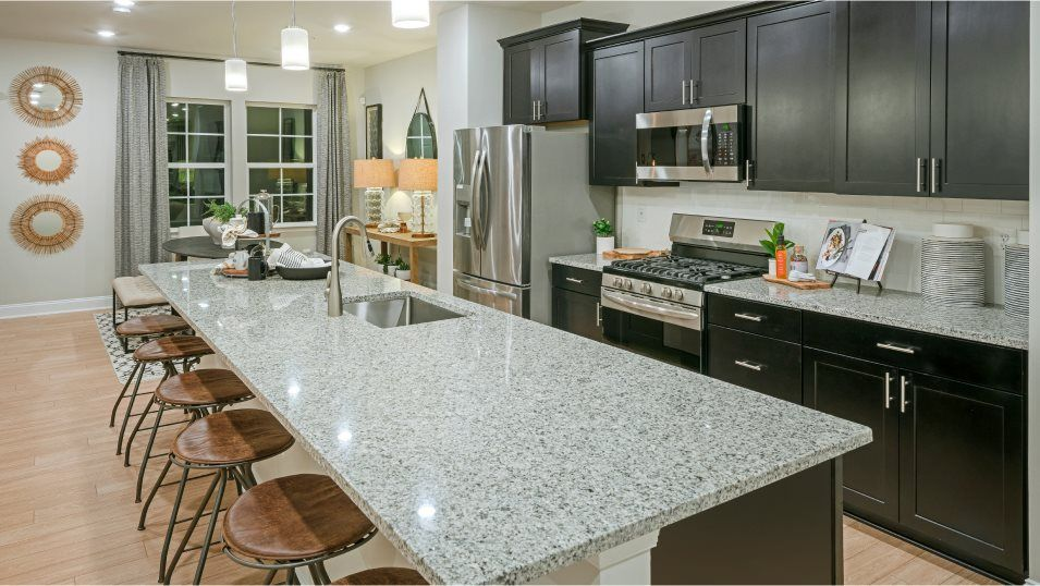 Parkside at Warfield Arcadia Rear Load Garage Kitc:The spacious kitchen is the star of the home and showcases an oversized center island for casual din