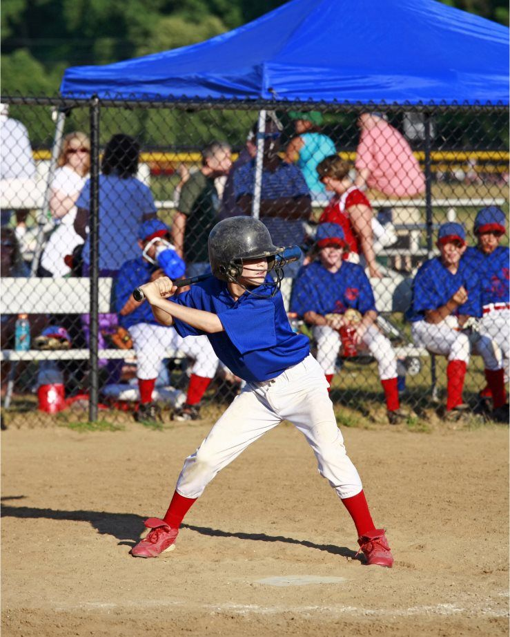 A child playing baseball
