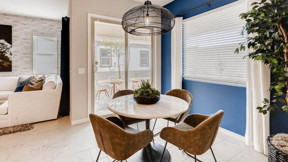 Heritage-at-Cadence Symphony Residence Eleven Dini:The dining area is located just off the kitchen and also provides access to the outdoor covered pati