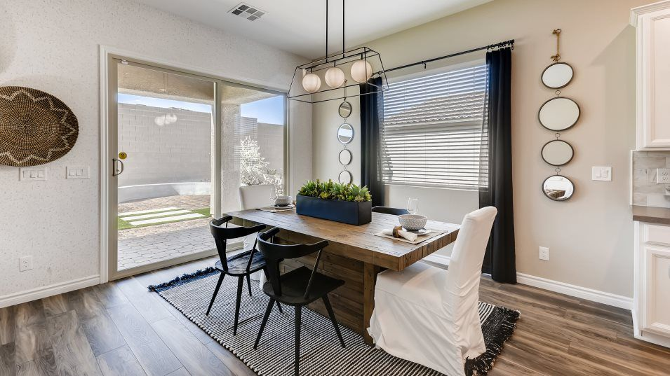 Heritage-at-Cadence Symphony Residence Thirteen Di:This bright dining room features sliding glass doors that flow to the patio for delicious meals unde