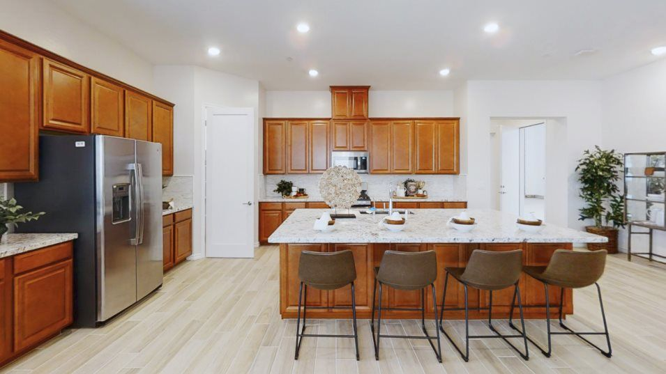 Encore at Heritage at Cadence Residence Two Kitche:With a wide layout for easy cooking, this modern kitchen is equipped with a flexible center island,