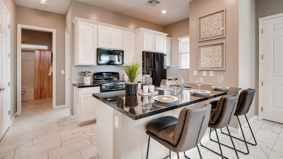 Courtyards at Heritage at Cadence Copper Kitchen:Designed for convenience, this modern kitchen features a stunning center island that doubles as a br