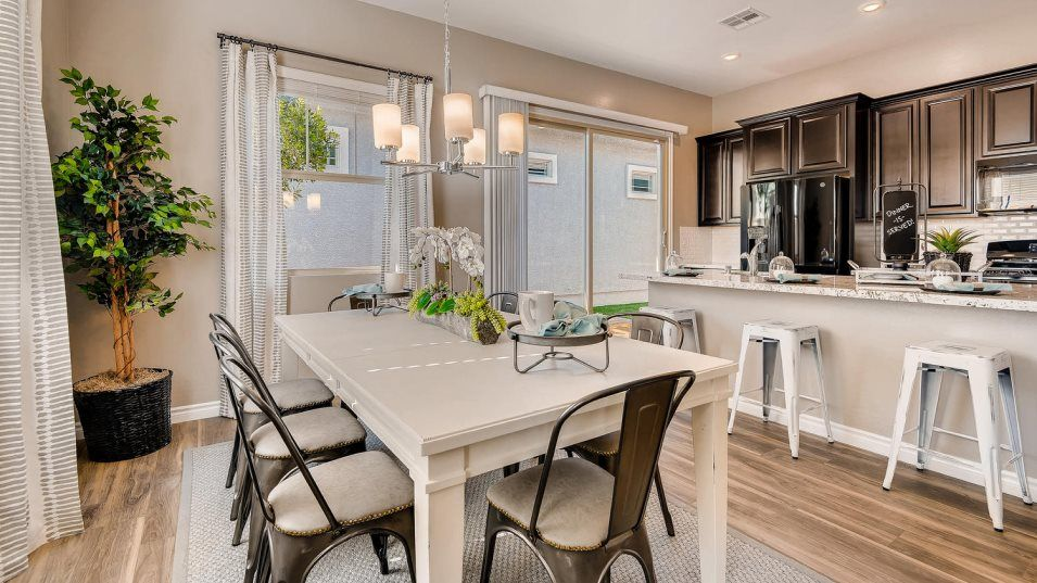 Courtyards at Heritage at Cadence Grayling Kitchen:For simplified cooking, this modern kitchen features a flexible center island that doubles as a brea