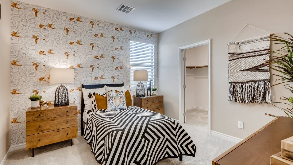 Delmar at Mira Arwen Bedroom:Two secondary bedrooms are located near the front of the home, one of which features a spacious walk