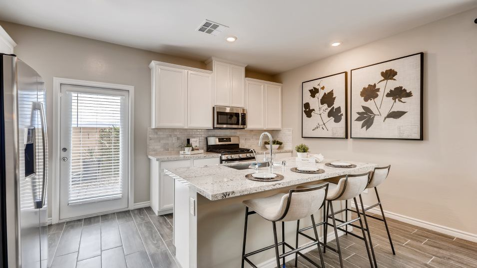 Delmar at Mira Mitchell Next Gen Kitchen:For easy meals, this kitchen is equipped with a center island that doubles as a breakfast bar, stain