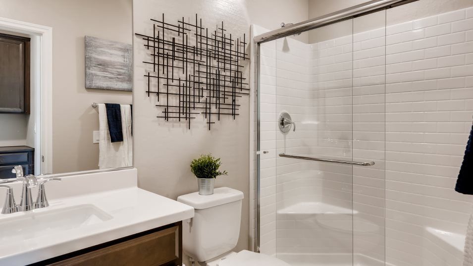 Delmar at Mira Brynn Bathroom:This first-level bathroom is situated close to a nearby bedroom, ideal for guests and family alike.