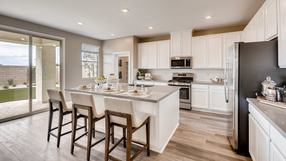 Aden Square Elliot Kitchen:For cooking up family feasts, this modern kitchen features a center island that doubles as a breakfa