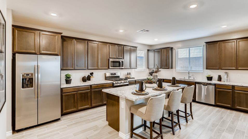 Silverado Valley The Crest Kingsbury Kitchen:This kitchen is equipped with a stunning center island that doubles as a breakfast bar, stylish Timb