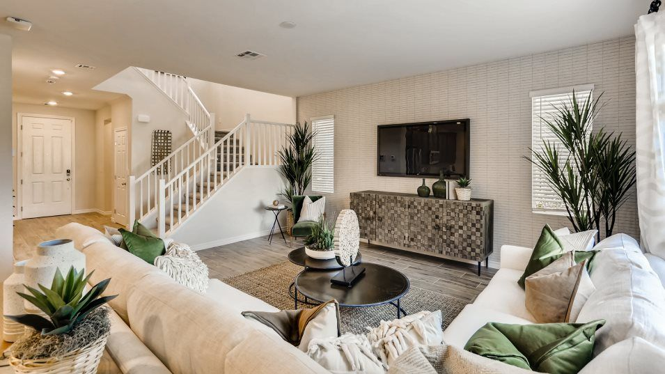 Valley Vista Granbury Preston Living Room:This sun-dappled living room enjoys plenty of natural light and flows seamlessly to the covered pati