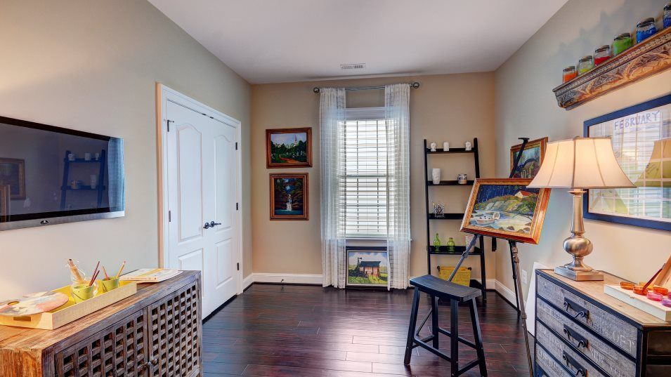 Colonial Heritage Colonial Heritage Manors Huntley:Versatile spaces include this flex room, perfect for an office space or pursuing hobbies.
