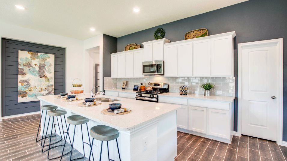 Potranco-Run Brookstone II, Westfield, & Barringto:Designed for the way busy families live today, the stylish kitchen comes well-equipped with a high-e