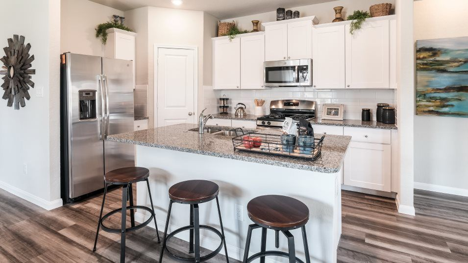Potranco-Run Brookstone II, Westfield, & Barringto:The kitchen has a contemporary layout with a convenient island, stainless steel appliances and ample