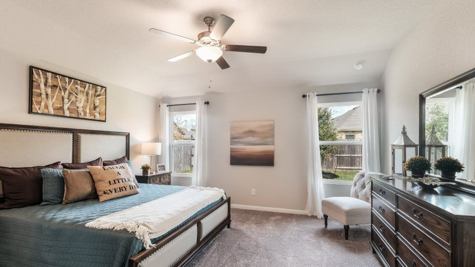 Potranco-Run Brookstone II, Westfield, & Barringto:The owner's suite is tucked into the back corner of the home for maximum privacy with large windows