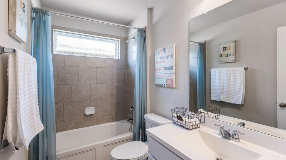 Hidden-Trails Westfield Collection Langley Bathroo:A full bathroom includes a combined shower and bathtub for added convenience during morning routines
