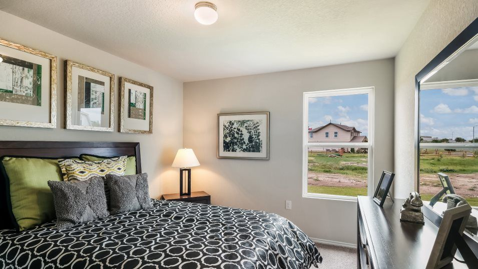 Northeast-Crossing Cottage & Watermill Collections:A secondary bedroom tucked into the back corner of the home has a walk-in closet and shares a bathro