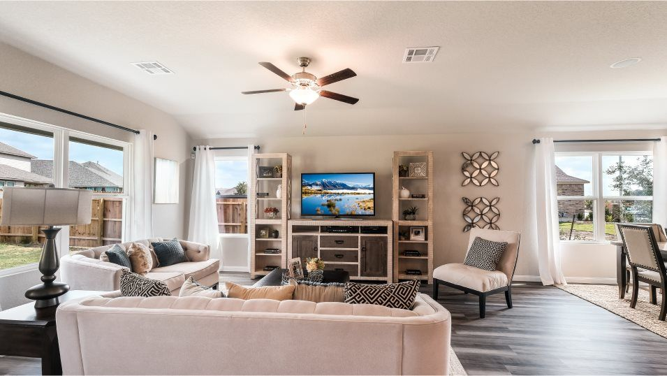 Summerhill Huxley Living Room:The comfortable living room gets great lighting with has ample space for furniture and back patio ac