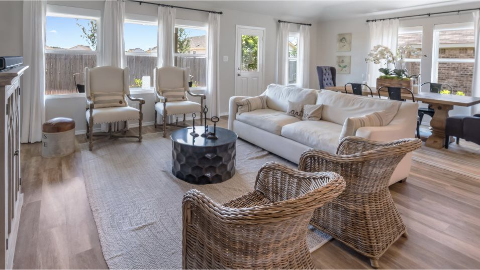 Heather Glen Jardin Family Room:The comfortable family room is the perfect place to unwind with plenty of space for furniture and ba