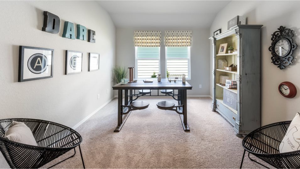 Heather Glen Jardin Retreat:A versatile retreat of the family room can be used as a home office or den