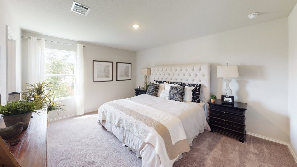 Rosillo Creek Rundle Owner's Suite:The owner's suite is tucked into the back of the home for maximum privacy, along with a full bathroo