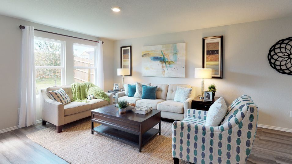 Rosillo Creek Drexel Family Room:Enjoy views of the backyard right from the comfort of your own couch in the family room
