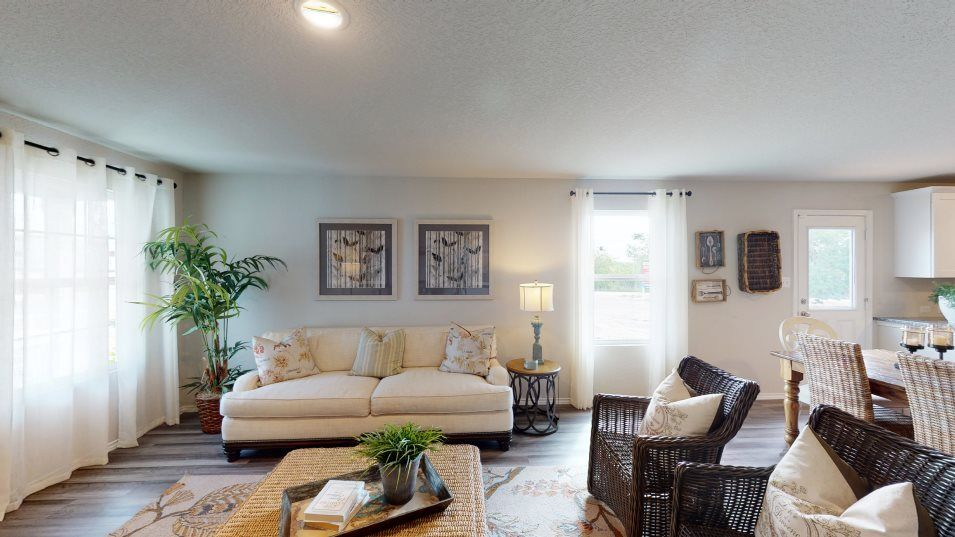 Republic Meadows Rundle Family Room:With great lighting from its large windows and ample space for furniture, the family room is the pla