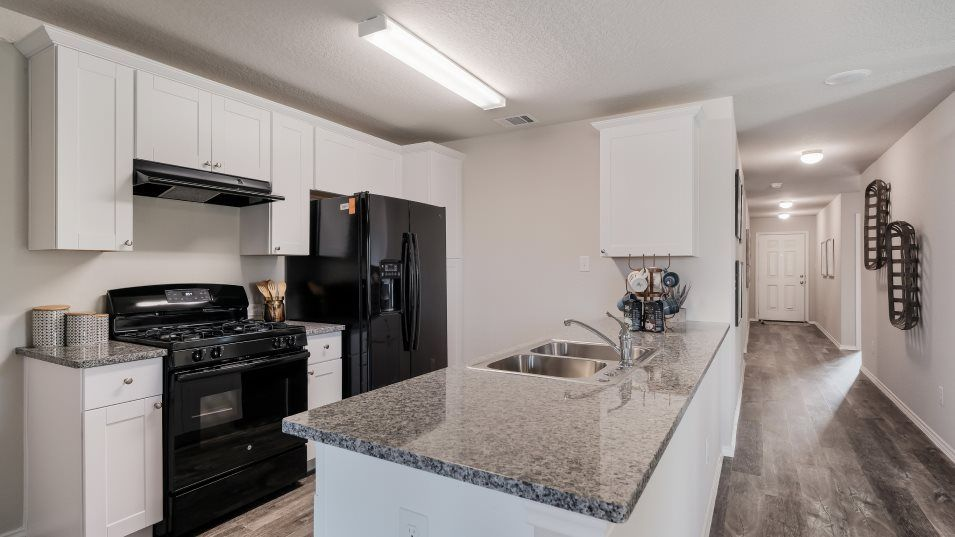 Vista Point Nettleton Kitchen:The kitchen flows seamlessly into the family room in a convenient open layout and features appliance