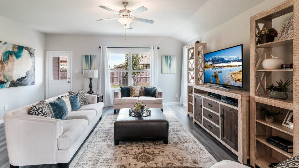 The-Ridge-at-Salado-Creek Barrington & Watermill C:The living room has everything you need to relax or entertain guests with plenty of space and back p
