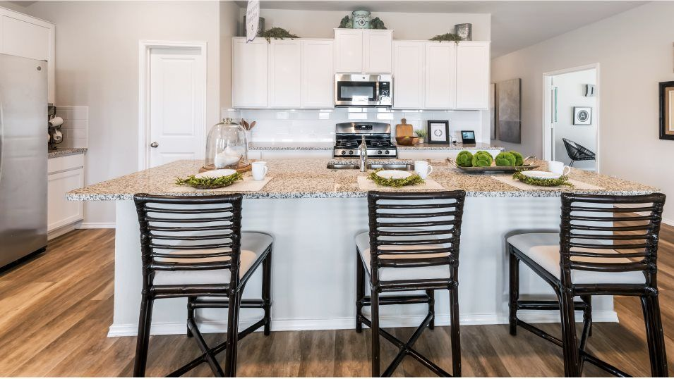 The-Ridge-at-Salado-Creek Barrington & Watermill C:The open concept kitchen features an open concept layout, stainless steel appliances and a center is