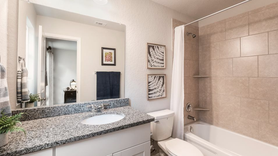 The-Ridge-at-Salado-Creek Barrington & Watermill C:A private bathroom attached to one of the secondary bedrooms features a WaterSense  Certified chrome
