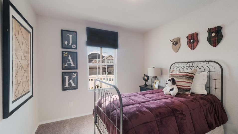 The-Ridge-at-Salado-Creek Watermill Collection Net:A secondary bedroom features views of the front porch and a large closet