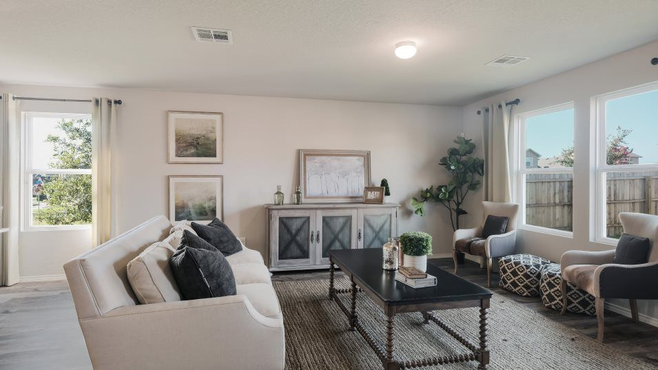 Rhine Valley Barrington & Watermill Collections Ne:The family room gets great lighting with ample space for furniture and backyard access.